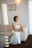 Beautiful happy bride posing at home Royalty Free Stock Photography