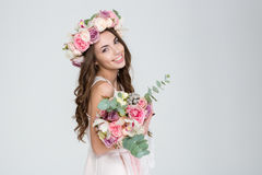 Beautiful happy bride in rose wreath holding bouquet of flowers Royalty Free Stock Photos