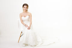 Beautiful happy bride in wedding dress on white background Stock Photography