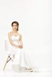 Beautiful happy bride in wedding dress on white background Stock Image