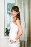 Beautiful happy bride in a white dress looking at camera Stock Images