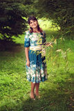 Beautiful happy brunette woman in the park on a warm summer day Royalty Free Stock Images