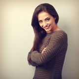 Beautiful happy brunette woman in warm sweater looking. Vintage Stock Images