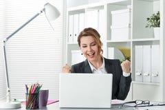 Beautiful happy business woman celebrating Royalty Free Stock Image