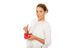 Beautiful happy businesswoman holding red wallet Royalty Free Stock Images