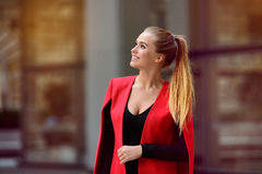 Beautiful happy businesswoman looking up and walking from the office stock photos