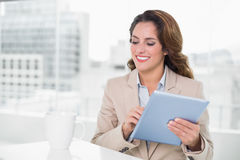 Beautiful happy businesswoman using tablet Stock Photography