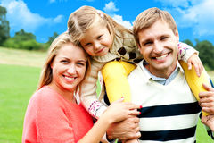 Beautiful happy caucasian family of three Royalty Free Stock Images
