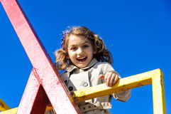Beautiful happy child girl at playground Royalty Free Stock Photos