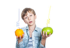 Beautiful happy child in stylish shirt holds an orange and a sweety with straws Stock Photos