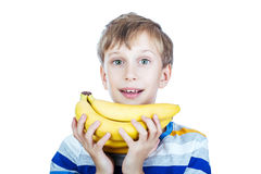 Beautiful happy child in stylish t-shirt holds a bunch of bananas Stock Images