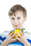 Beautiful happy child in stylish t-shirt holds colorful lemons Royalty Free Stock Photo