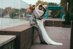 Beautiful happy couple in bohemian style posing. For wedding shoot stock image