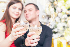 Beautiful happy couple celebrating New Year, holding glasses of champagne Stock Photography