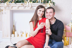 Beautiful happy couple celebrating New Year, holding glasses of champagne Royalty Free Stock Images