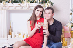 Beautiful happy couple celebrating New Year, holding glasses of champagne Stock Photo
