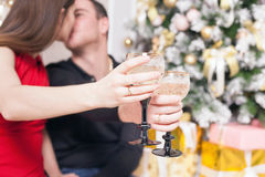 Beautiful happy couple celebrating New Year, holding glasses of champagne Royalty Free Stock Photos
