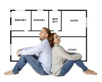 Beautiful happy couple dreaming of buying and design their future first house stock image