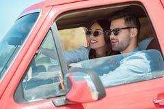 beautiful happy couple driving stock photos