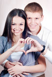 Beautiful happy couple with heart of love Royalty Free Stock Images