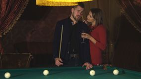 Beautiful happy couple playing billiards stock video footage