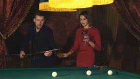Beautiful happy couple playing billiards stock footage