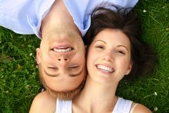 Beautiful and happy couple smiling Stock Photography