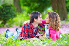 Beautiful happy couple in summer park Stock Photo