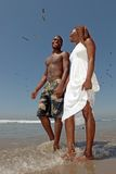 Beautiful Happy Couple Walking Along the Beach Stock Photo