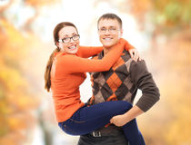 Beautiful and happy couple walking and embracing in the autumn park Stock Photos