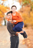 Beautiful and happy couple walking and embracing in the autumn park Royalty Free Stock Images
