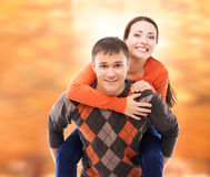 Beautiful and happy couple walking and embracing in the autumn park Stock Photography