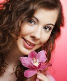 Beautiful happy woman with orchid flower over pink background Stock Image