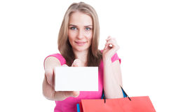 Beautiful happy customer holding blank or empty business card Royalty Free Stock Photos