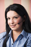 Beautiful happy customer service representative. Close up of beautiful happy customer service representative woman with headset.Check also,for pictures similar Royalty Free Stock Photo