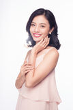 Beautiful happy cute asian woman in casual pink dress with red l. Ips on white background stock photography