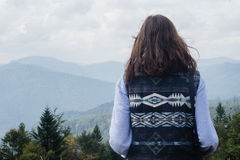 Beautiful happy cute stylish girl  in the mountains on a backgro Royalty Free Stock Photography