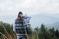 Beautiful happy cute stylish girl  in the mountains on a backgro Stock Photography