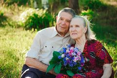 Beautiful happy eighty years old people sitting in the park royalty free stock images