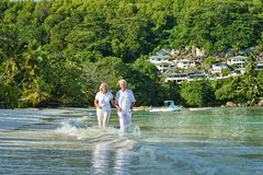 Elderly couple rest at tropical resort Stock Photo