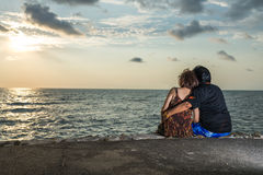 Beautiful happy elderly couple rest at tropical resort,back view Royalty Free Stock Photography