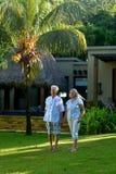Beautiful happy elderly couple walking outdoors Royalty Free Stock Photos