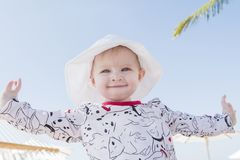 Beautiful Happy Expressive Blond Girl Toddler in a Hammock on the Beach Stock Photos