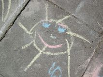 Happy face painted on path, Lithuania stock images