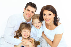 Beautiful happy family. Isolated over a white background royalty free stock images
