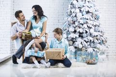 Beautiful happy family mother, father, son, and daughter to cele. Brate Christmas and new year together at home Stock Image