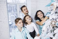 Beautiful happy family mother, father, son, and daughter to cele. Brate Christmas and new year together at home Stock Images