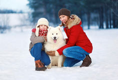 Beautiful happy family, mother and son walking dog Royalty Free Stock Images
