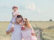 Happy family outdoor. The beautiful happy family outdoor Stock Photo