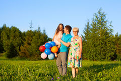 Beautiful happy family  outdoors during sunset with balloons Royalty Free Stock Photography